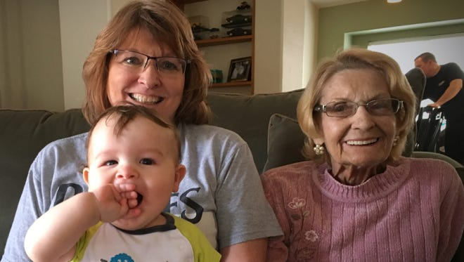 Marilyn Poure (right); her daughter, Susan McHugh; and grandson, Rylan; pictured in an undated photograph. Poure died in 2016 of heat-related causes.