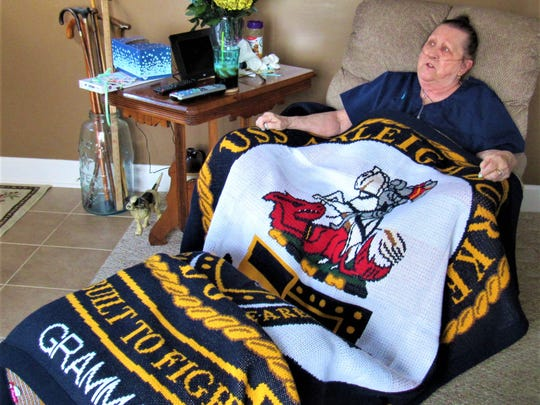 This blanket is a treasured gift from Chloris Cooley's granddaughter Sarah Amsbury, who serves in the U.S. Navy on the USS Arleigh Burke.