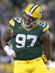 Green Bay Packers nose tackle Kenny Clark reacts to