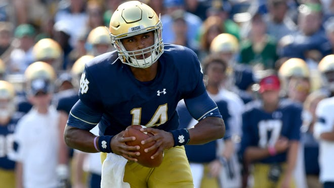 Notre Dame Fighting Irish quarterback DeShone Kizer (14) runs for a touchdown in the first quarter against the Duke Blue Devils at Notre Dame Stadium.