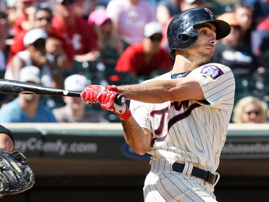 Minnesota Twins' Zack Granite flies out to left field in his first major league at bat against the Baltimore Orioles in the eighth inning of a baseball game, Saturday, July 8, 2017, in Minneapolis. The Orioles won 5-1. (AP Photo/Tom Olmscheid)