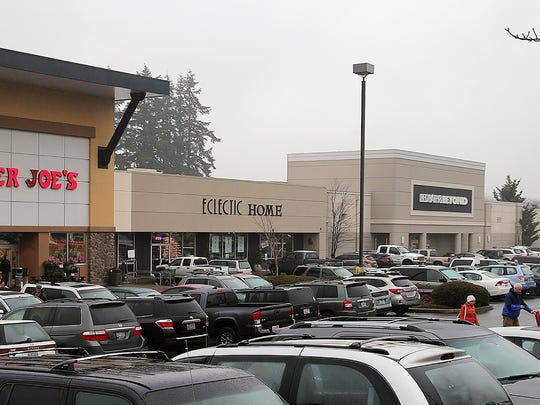 A strip mall  witch is  anchored by Trader Joe's, Goodwill, and Bed Bath & Beyond, in Silverdale on a misty, gray Monday.