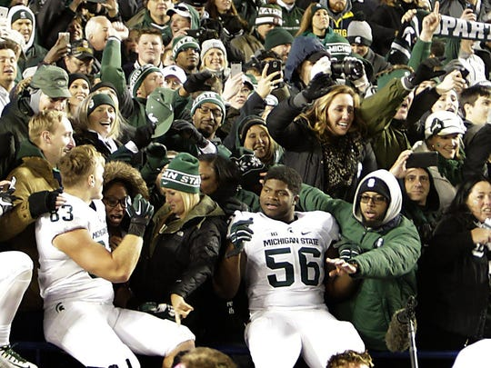 Michigan State celebrates with its fans in the Big House after the stunning finish to the annual showdown with Michigan. The Spartans have beaten the Wolverines seven times in the last eight tries under Mark Dantonio.