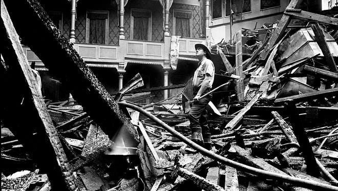Nashville firefighter Marlon Claiborne inspects the still smoldering ruins of the 1,200-seat auditorium of the 80-year-old Loew's Vendome Theater Aug. 9, 1967. The theater was gutted and the roof caved in by flames that raged out of control from about 2 a.m. until 5 a.m.