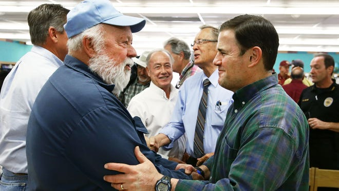 Arizona Gov. Doug Ducey (right) talks with Dewey-Humboldt Mayor Terry Nolan in Prescott Valley during the Goodwin Fire on June 29, 2017.