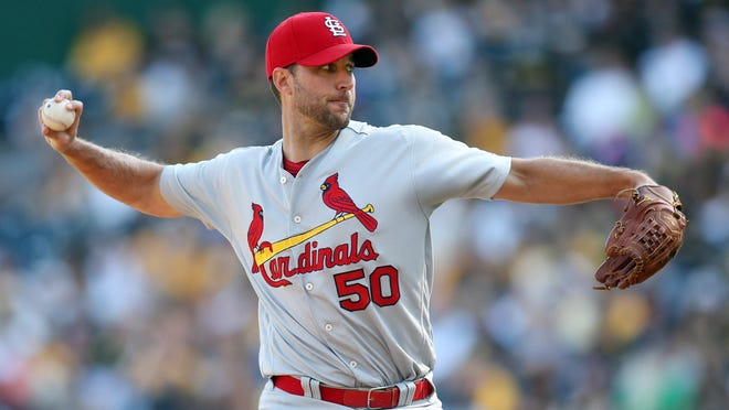 Cardinals starting pitcher Adam Wainwright (50) delivers against the Pittsburgh Pirates during the first inning.