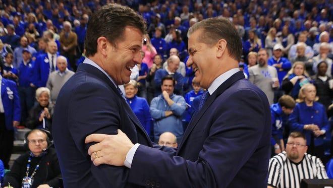 UCLA's Steve Alford and UK's John Calipari greet before the game.