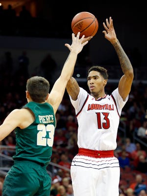 Louisville's Ray Spalding takes a shot over William & Mary's Justin Pierce.  
