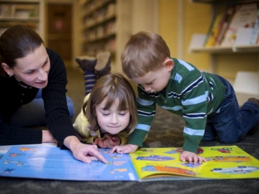 Kara Koller reads with her children Leah, 5, and Elliott, 2, at Martin Library in November. (DAILY RECORD/SUNDAY NEWS -- KATE PENN)