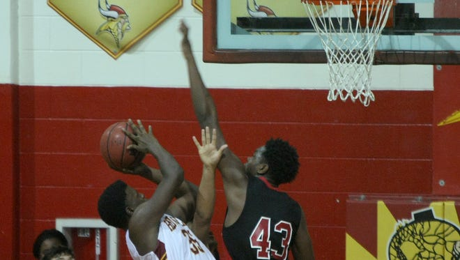 Humboldt's Justin Pankey (35) draws a foul from Bradford's C.J. Sidell (43) at Humboldt High School in Humboldt, Tenn., on Tuesday, Dec. 6, 2016.