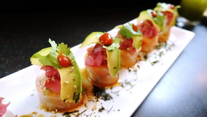 Special roll with snow crab, salmon, tuna, rice paper, avocado, cilantro and Sriracha at Makitto Sushi in Mesa.
