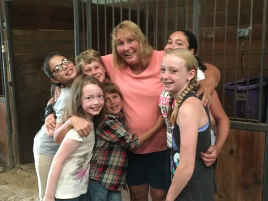 Dotty Orzechowski, farm owner and camp director, gets
