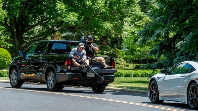 """Accord Productions director of photography Rocky Wyler, left, and camera operator Daniel Kaplan film from the back of a Honda pickup truck Thursday, June 18, 2020 for an episode of the History Channel television show """"It's How You Get There"""" on Grandview Drive in Peoria Heights."""