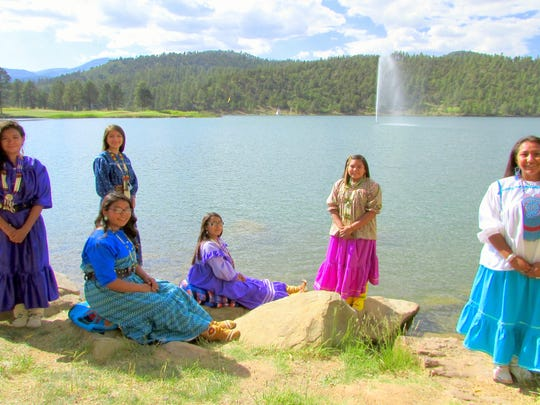 Wearing their camp dresses and moccasins, Mescalero maidens from left standing are Amber Lathan, Allysa Kazhe, Shaylee Mangas and Haley Apache-Tsinnijinnie. Seated from left are Jerica Mancito-Baca and Tahnice Moreno.