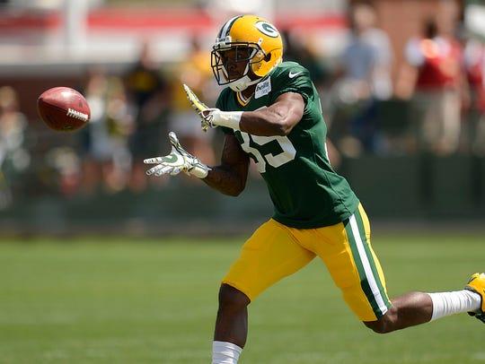 Packers cornerback Demetri Goodson (39) makes a catch