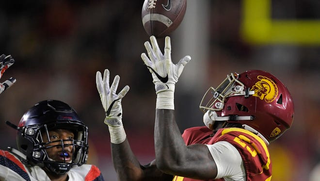 Southern California running back Ronald Jones II, right, makes a catch as Arizona linebacker Tony Fields II defends during the second half of an NCAA college football game, Saturday, Nov. 4, 2017, in Los Angeles. USC won 49-35. (AP Photo/Mark J. Terrill)