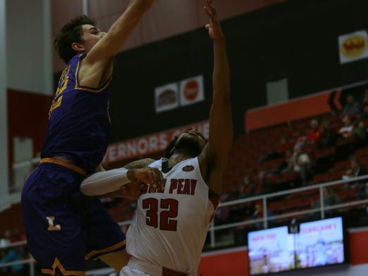 Lipscomb's Eli Pepper attempts to block Austin Peay's