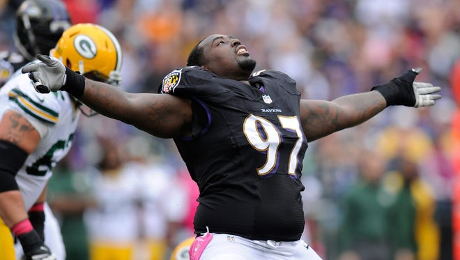 New Colts defensive end Arthur Jones reacts to his sack of Green Bay Packers quarterback Aaron Rodgers, Oct. 13, 2013.