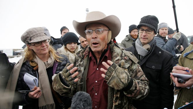 "In this Jan. 5, 2016 file photo, Robert ""LaVoy"" Finicum, center, a rancher from Arizona, talks to reporters at the Malheur National Wildlife Refuge near Burns, Ore. An FBI agent has been indicted on accusations that he lied about firing at Finicum in 2016 when officers arrested leaders of an armed occupation of a federal wildlife refuge in rural Oregon. Sources familiar with the case say the agent will face allegations of making a false statement with intent to obstruct justice, The Oregonian/OregonLive reported Tuesday, June 27, 2017."