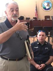 Liberty city resident Rick Robertson debates Saturday