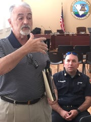 Liberty city resident Rick Robertson debates Saturday with Mayor Eric Boughman about how much the city's recreation department and fees charged to outside users, as City Fire Chief Chris Rowland looks on.