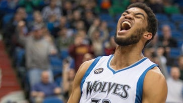 Mar 23, 2016; Minneapolis, MN, USA; Minnesota Timberwolves center Karl-Anthony Towns (32) celebrates after dunking the ball in the second half against the Sacramento Kings at Target Center. The Timberwolves won 113-104. Mandatory Credit: Jesse Johnson-USA TODAY Sports