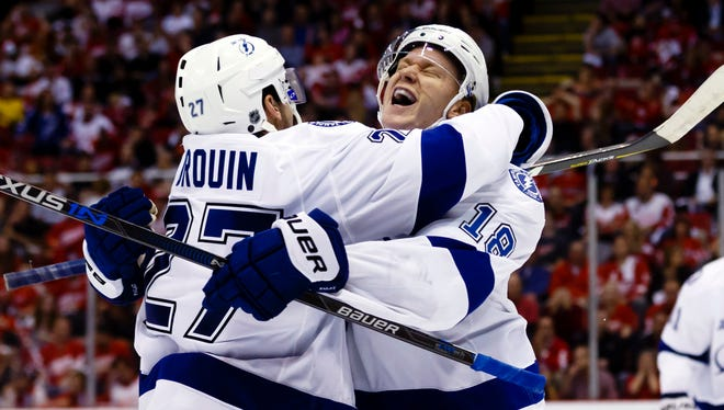 Tampa Bay Lightning left wing Ondrej Palat (18) celebrates his goal during the third period with left wing Jonathan Drouin (27).