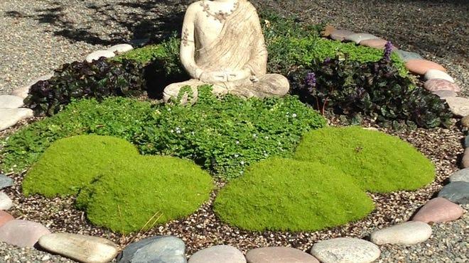 Buddha keeps a serene watch over Paul and Barbara Jacksons' Grants Pass Zen rock garden