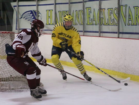 Hartland's Justin Tulpa gets to the puck behind the