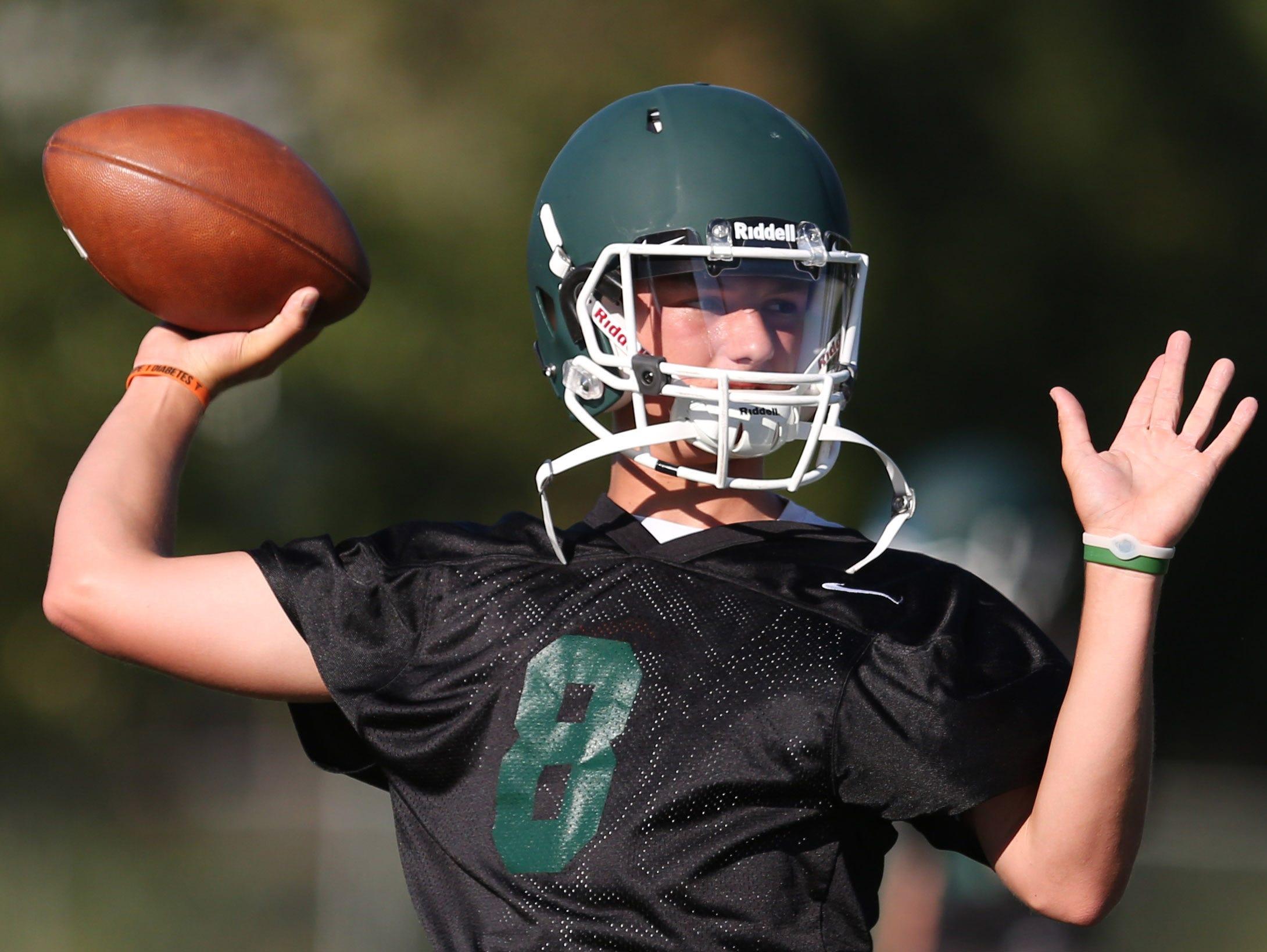 Senior quarterback Colton Daniels during practice on Wednesday, Aug. 16, 2016, at Salem Academy.