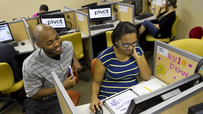 Pivot Charter School in Fort Myers, a sixth-through-12th grade school, is closing its doors. Pictured in this file photo from 2013 are Pivot Charter School math teacher Darrell Comrie, who works with then-senior Kayla Stone.