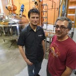 Owners David Monahan, right, and Jamie Gulden, stand by their new 600-gallon distiller at Feisty Spirits on Monday Sept. 29, in Fort Collins.