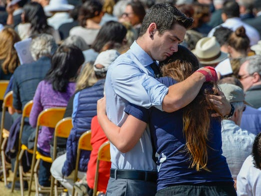 Students hug before the start of a memorial service at Harder Stadium for the slain University of California-Santa Barbara students.