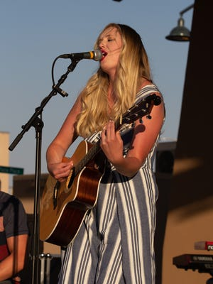 Alyssa Newton plays for the crowd at the Homeward Bound Country on the Plaza music show on Saturday, June 2, 2018.