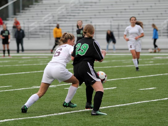 Lindsey Slone, left, works against a Mountain Heritage