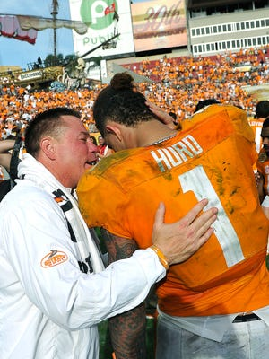 Coach Butch Jones talks with Jalen Hurd after leading Tennessee to a 45-6 victory over Northwestern in the Outback Bowl on Jan. 1, 2016.