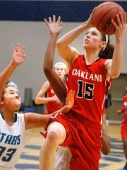 Oakland's Sloan Mann (15) goes up for a shot as Siegel's Morgan Pepelea (33) defends her on Tuesday, Dec. 5, 2017, at Siegel.