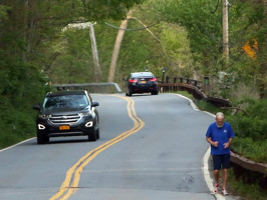 Former late night talk show host David Letterman jogs along a road near his home in North Salem Thursday May 12, 2016.