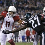 Cardinals receiver Larry Fitzgerald gets past Eagles safety Malcolm Jenkins in Sunday night's game.