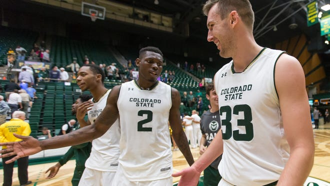 CSU basketball players Emmanuel Omogbo (2) and Braden Koelliker celebrate Sunday after a season-opening win over New Mexico State at Moby Arena.