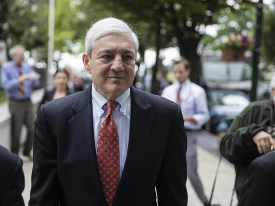 Former Penn State President Graham Spanier departs after his sentencing hearing June 2, 2017 at the Dauphin County Courthouse in Harrisburg, Pa.