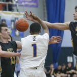 Honeoye Falls-Lima's Josh D'Agostino looks at the ball tapped by teammate Tommy Eastman before Irondequoit's DeRon Williams could get to it in the third quarter at Irondequoit High School.
