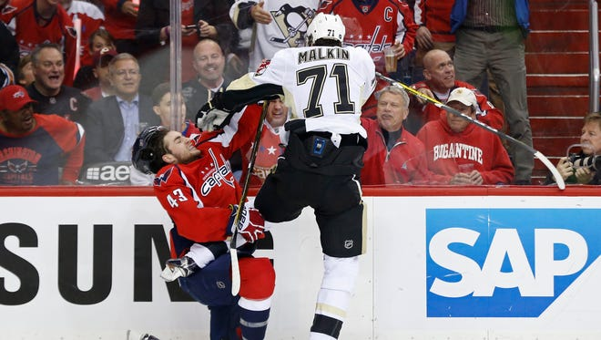 Pittsburgh Penguins center Evgeni Malkin (71) and Washington Capitals right wing Tom Wilson (43) get into an altercation in the second period in game one of the second round of the 2016 Stanley Cup Playoffs at Verizon Center.
