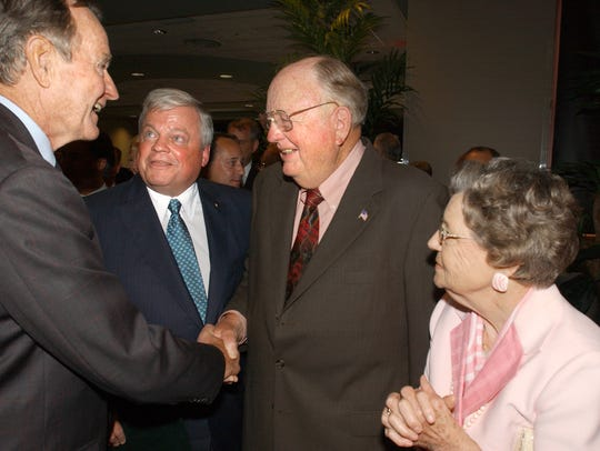 Former president George Bush is introduced to Red Dumesnil and his wife Gertrude by Richard Zuschlag during a reception Friday, April 28, 2006.