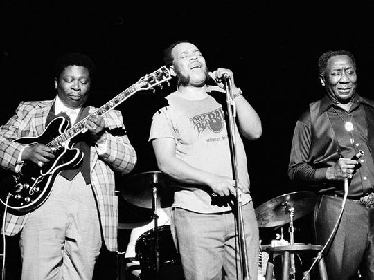 Blues musician B.B. King, left, James Cotton, center, and Muddy Waters perform together at radio city music hall in New York on June 29, 1979.