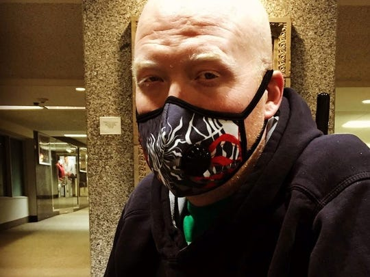 Colorful face masks worn by many patients are a constant