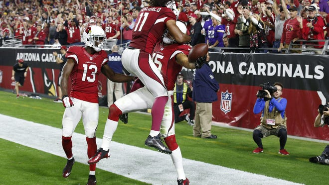 Arizona Cardinals wide receiver Michael Floyd (15) celebrates after scoring a touchdown against the Minnesota Vikings with Larry Fitzgerald (11) during the second half their Dec. 10 game in Glendale, Ariz.