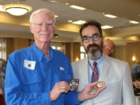 "Garry Piattoni, appraiser from PBS' ""Antiques Roadshow"" poses with Henry Quigley, who has a 1916 World Series championship pocket watch. Quigley's grandfather, Ernest Quigley, was an umpire."