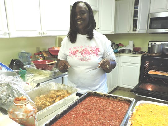 Thelma Washington, executive director of Gertrude Walden Child Care Center, helps prepare the food for the 2018 spaghetti dinner fundraiser.