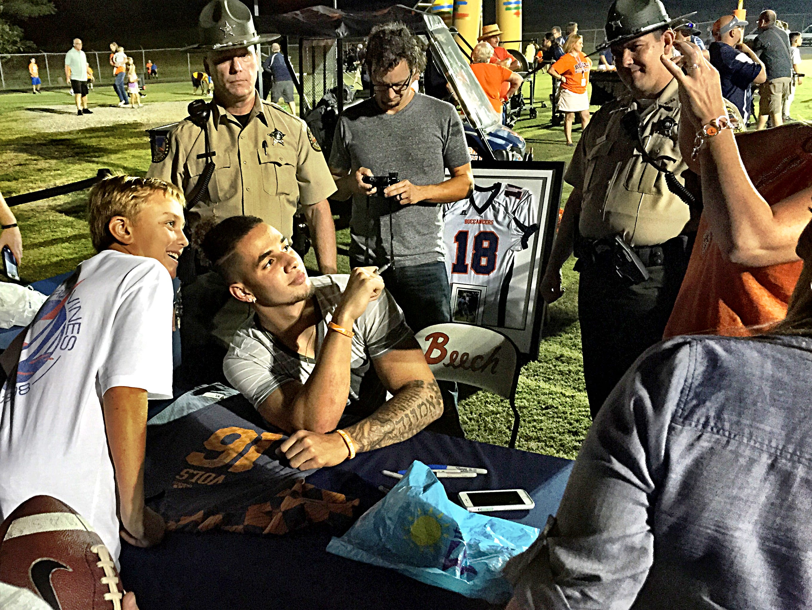 University of Tennessee sophomore tailback Jalen Hurd poses for a photo with a young fan during an autograph-signing session on Friday evening. Hurd had his jersey retired by Beech High School during halftime of the Buccaneers' home opener against Rossview.